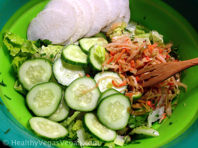 Romaine salad with cucumbers daikon sauerkraut lemon